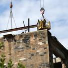 Work is ongoing to safely remove parts of the Mackintosh building after a devastating fire (David Cheskin/PA)