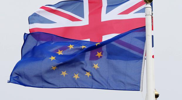 EU citizens living in the UK will be able to apply for 'settled status' (Niall Carson/PA)