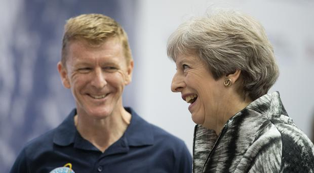European Space Agency astronaut Tim Peake speaks to Prime Minister Theresa May as she opens the Farnborough International Airshow in Hampshire (Matt Cardy/PA)