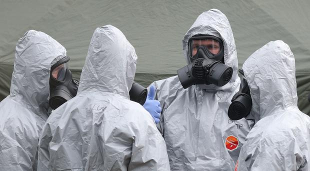 Military personnel investigating the poisoning of Sergei Skripal in a Salisbury car park (Andrew Matthews/PA)