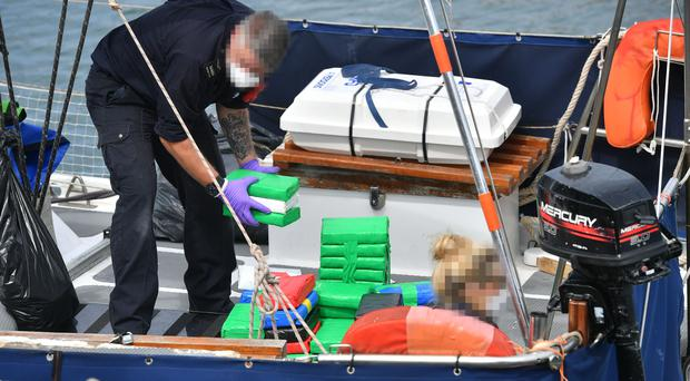 Drugs are unloaded from a boat by officers at Newlyn harbour (Ben Birchall/PA)