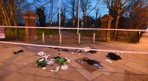 Bloodied clothes on the ground near a stabbing in London (PA)