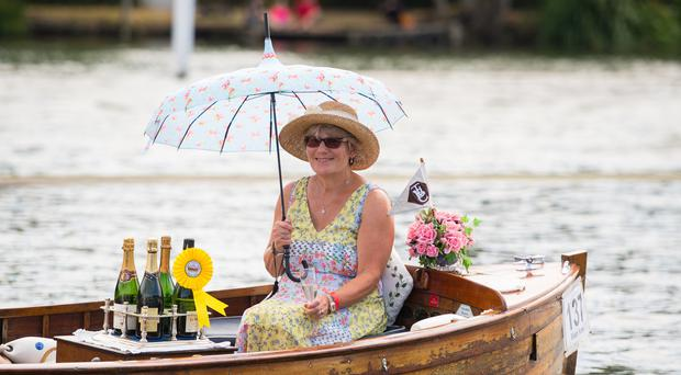 A woman enjoys the warm weather at Henley-on-Thames (Dominic Lipinski/PA)