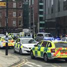 Police at the scene near the Hilton Hotel, Deansgate, Manchester (Anthony Hilton/Twitter/PA)