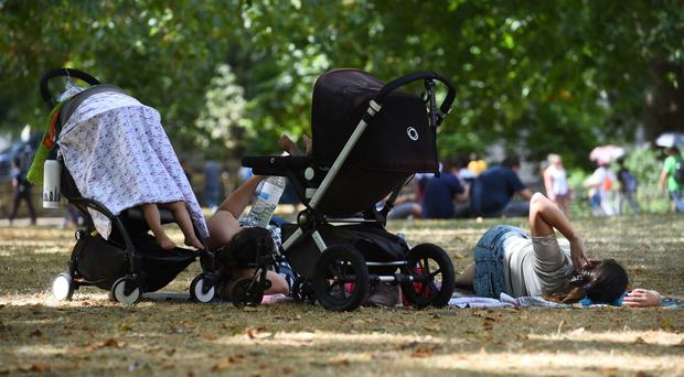 Children are sheltered from the heat in St James's Park (Kirsty O'Connor/PA)