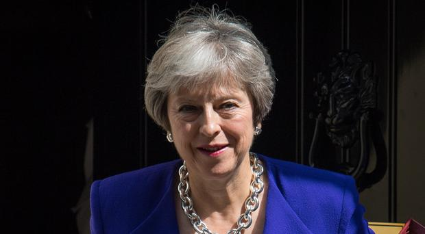 Prime Minister Theresa May is to announce pay rises of between 1% and 4% for public sector workers (Dominic Lipinski/PA)