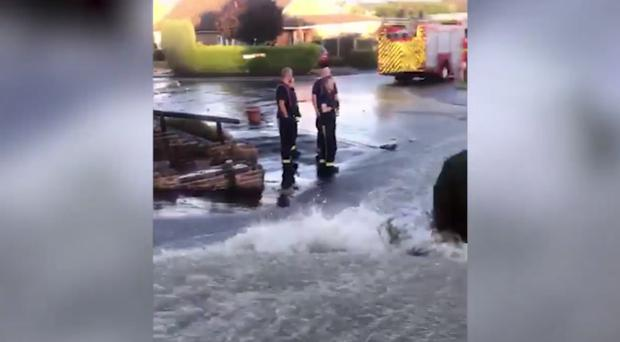 The flooding was filmed in Fallowfield Road (Screengrab/PA)