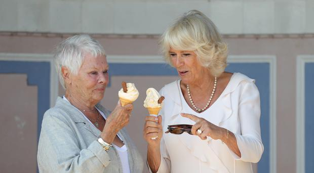 The Duchess of Cornwall enjoys an ice cream with Dame Judi Dench (Andrew Matthews/PA)