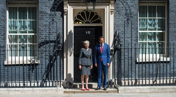 Prime Minister Theresa May greets Emir of Qatar, Tamim bin Hamad Al Thani as he arrives in Downing Street (Dominic Lipinski/PA)
