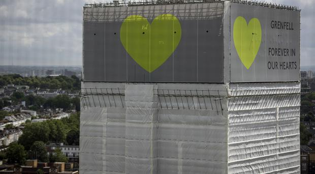 Grenfell Tower in London (Victoria Jones/PA)