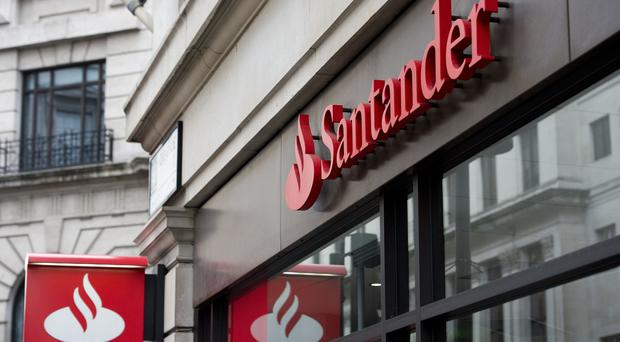 High street banking giant Santander has reported half-year profits diving 18% amid a 'competitive and uncertain' market and said it will focus heavily on cutting costs (Laura Lean/PA)