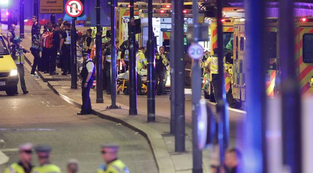 Emergency workers tending to the wounded after the London Bridge terror attack (PA)