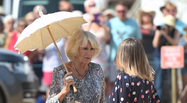 The Prince of Wales and the Duchess of Cornwall during a visit to the Sandringham Flower Show (Joe Giddens/ PA)