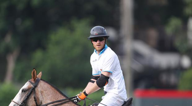 Prince Harry taking part in the last Sentebale Polo Cup (Steve Parsons/PA)