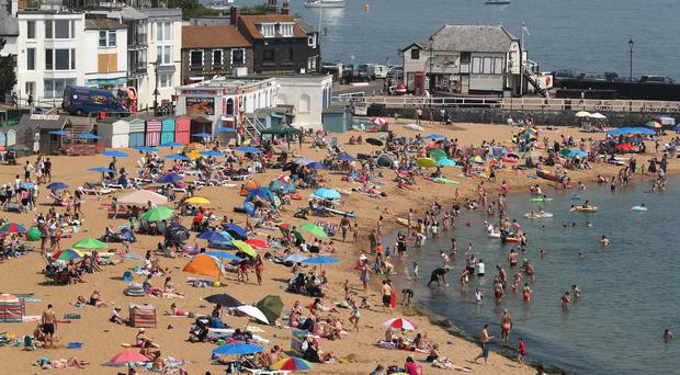 People enjoy the beach in Broadstairs, Kent, as the hot weather continues across the country (Gareth Fuller/PA)
