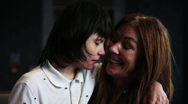 Billy Caldwell, who has a rare form of epilepsy, with his mother Charlotte (PA)