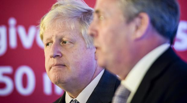 Boris Johnson MP (left), former Mayor of London and leading Vote Leave campaigner, speaks at Armada House in Bristol as he outlines a positive vision for Brexit, watched by former Defence Secretary Dr Liam Fox.
