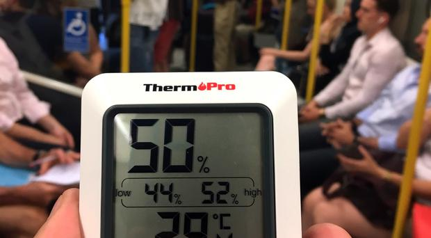 A thermometer showing 29.4C on the Circle line during rush hour. Rush-hour commuters on the London Underground sweltered in temperatures above the legal limit for transporting livestock on Thursday, the hottest day of the year so far.