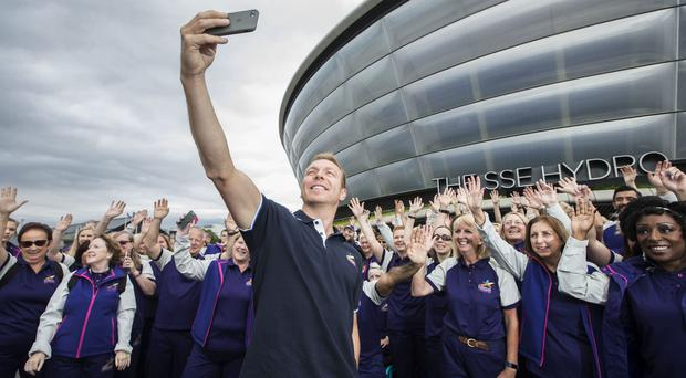 Sir Chris Hoy meets volunteers for the Glasgow 2018 European Championships (Colin Templeton/PA)