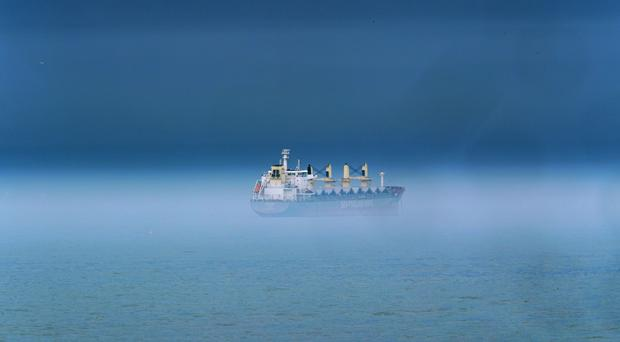 A ship in the mist off the north-east coast near Whitley Bay as storms move up the coast (Owen Humphreys/PA)