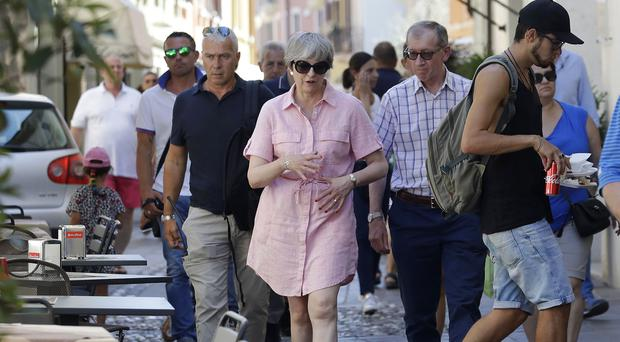 Prime Minister Theresa May and her husband Philip visit Desenzano del Garda on a previous visit to Italy (Antonio Calanni/PA)