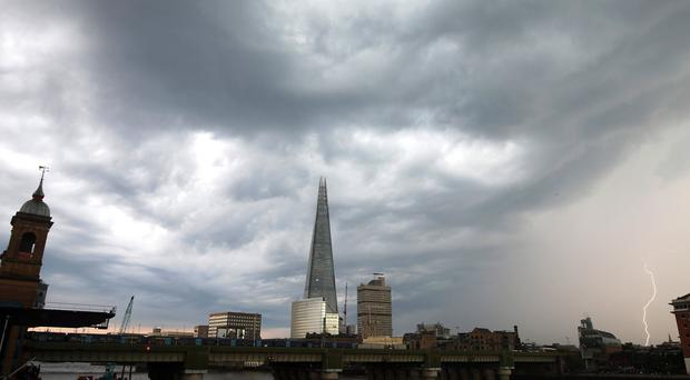 Lightning strikes near The Shard in London (Yui Mok/PA)
