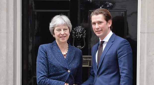Prime Minister Theresa May welcomes Austrian Chancellor Sebastian Kurz to Downing Street (John Stillwell/PA)