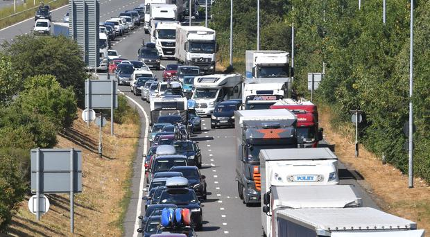 Traffic queueing on the M20 approaching the Eurotunnel terminal in Folkestone, Kent (John Stillwell/PA)