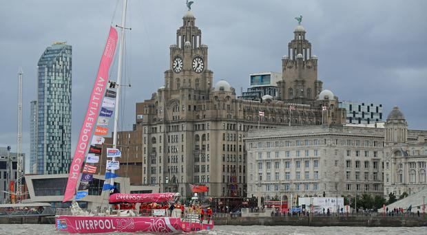 The Liverpool 2018 team arrives at the finish line after a 'sprint finish' to conclude the Clipper 2017-2018 Round the World Yacht Race outside the Royal Albert Dock in Liverpool (Peter Byrne/PA)