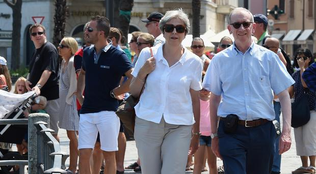 Prime Minister Theresa May and her husband Philip visit Desenzano del Garda in Italy (Pier Marco Tacca/PA)
