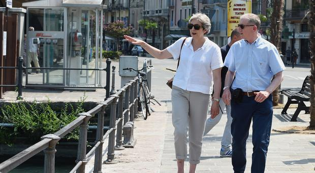 Prime Minister Theresa May and her husband Philip visit Desenzano del Garda in Italy, during their summer holiday (Pier Marco Tacca/PA)