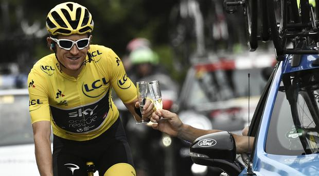 Geraint Thomas toasts with champagne with Team Sky principal Sir Dave Brailsford (Marco Bertorello, Pool via AP/PA)