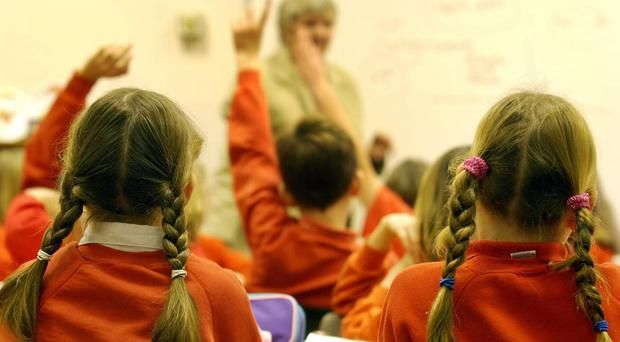 Overall, parents are paying on average £754 extra per primary school child, with the figure rising to £1,160 for those in secondary schools (stock picture)