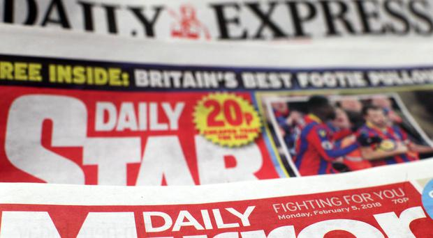 Reach, formally known as Trinity Mirror, reported a £113.5m statutory pre-tax loss in the first half of the year (Yui Mok/PA)