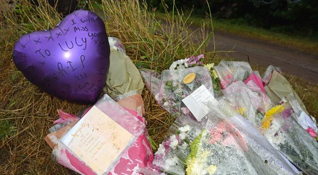 Floral tributes left at the scene near Southampton Sports Centre where 13-year-old Lucy McHugh was found stabbed to death (Ben Mitchell/PA)