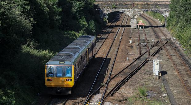 A Northern Rail train travels through Hunts Cross Station in Liverpool (Peter Byrne/PA)