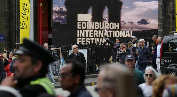 Police will maintain a high-visibility presence in Edinburgh over the festival season as part of an annual safety campaign (David Cheskin/PA)
