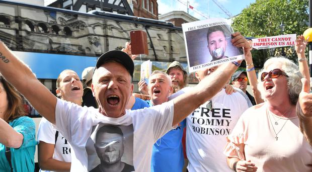 Supporters of Tommy Robinson celebrate outside the Royal Courts of Justice (John Stilwell/PA)