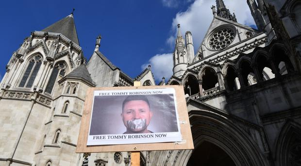 Supporters of former English Defence League (EDL) leader Tommy Robinson outside the Royal Courts of Justice in London, as he attempts to challenge his 13-month prison term for contempt of court.