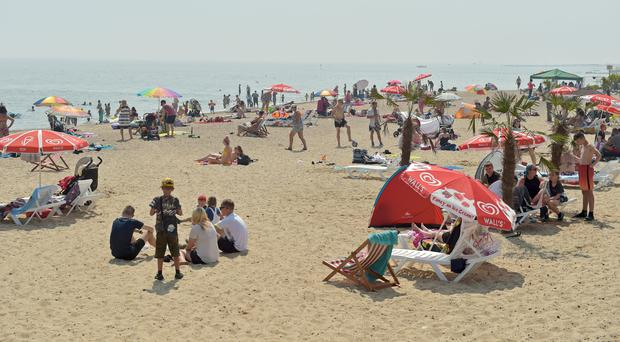 People enjoy the sunshine on the beach at Clacton-on-Sea in Essex, during July's heatwave. (Image: PA)
