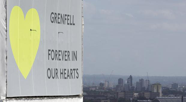 Grenfell Tower, now covered in plastic sheeting, will be managed by the Government (Rick Findler/PA)