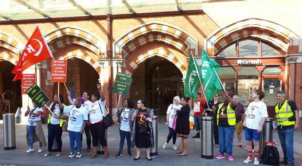 RMT members outside St Pancras station in London (RMT/PA)