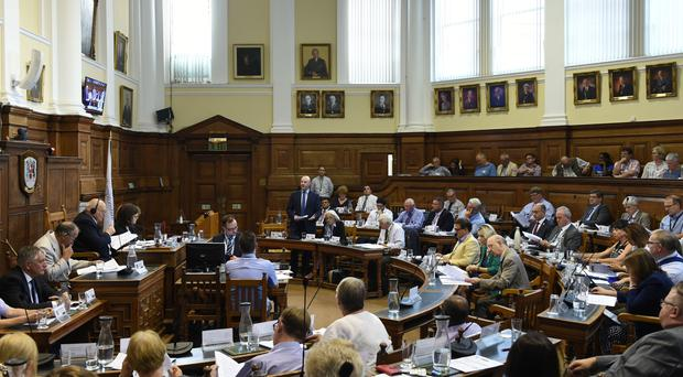 Northamptonshire County Council leader Matthew Golby (centre) speaks at the council's extraordinary meeting in Northampton (Joe Giddens/PA)