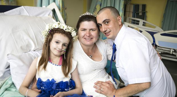 Kayleigh Walsh with parents Lyndsey and Paul Walsh (Danny Lawson/PA)