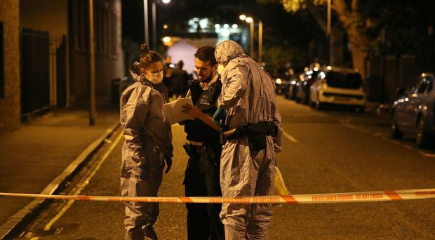 Forensic officers in Warham Street in Camberwell, south London, where drill rapper Incognito was killed and two other people were injured in a stabbing (Jonathan Brady/PA)