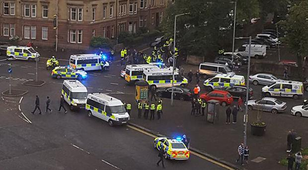 Emergency services were called to deal with mass brawls and violence outside Ibrox (@Chirray/PA)