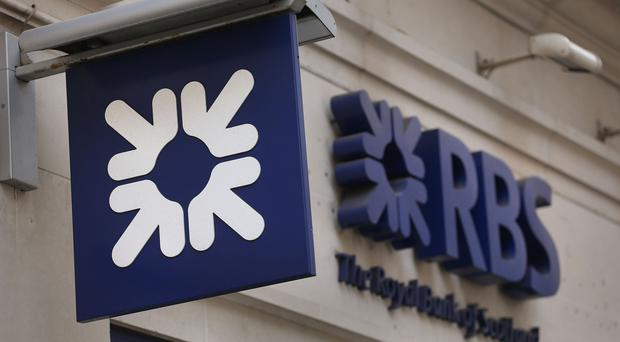 RBS has seen bottom-line profits drop after being hit by a major settlement with US authorities (Philip Toscano/PA)