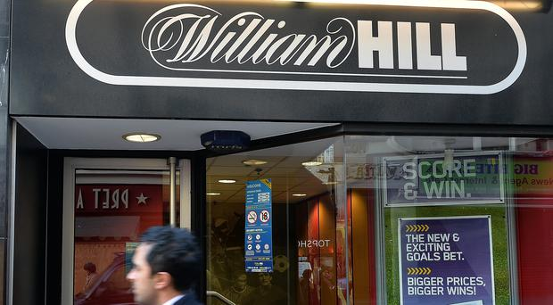 William Hill reported a bottom line pre-tax loss of £819.6 million for the six months to June 26 (John Stillwell/PA)