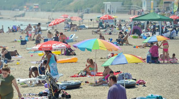 Hot weather was one of the factors behind activity in Britain's powerhouse services sector slipping to a three-month low in July (Nick Ansell/PA)