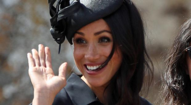 Meghan waves to well-wishers at the wedding (Yui Mok/PA)